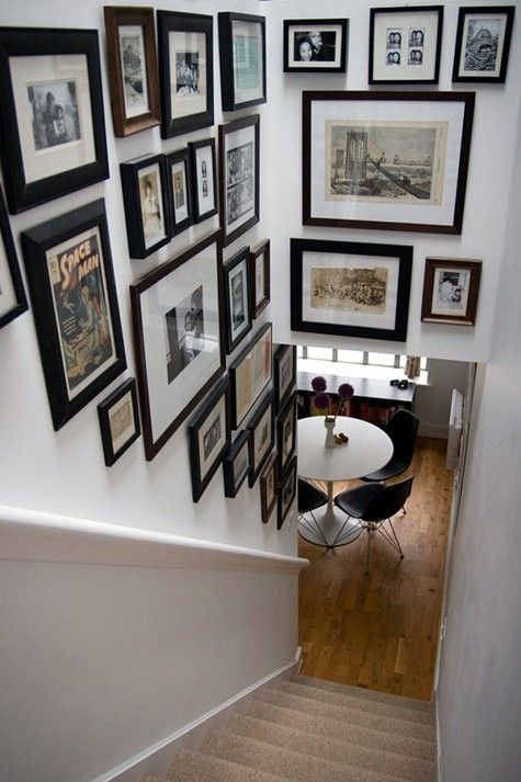 Basement stairs - all same frame color, b+w family photos?