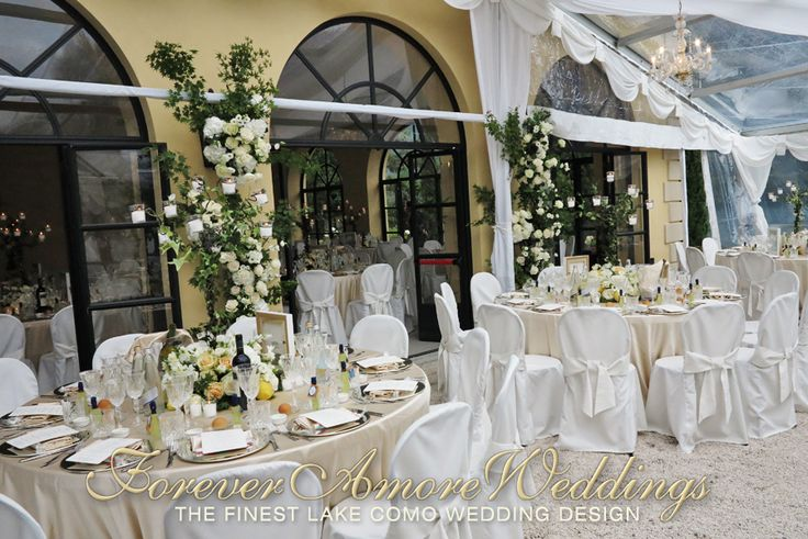 Lake Como wedding reception, Villa Balbianello, Loggia Segrè's terrace covered with crystal marquee. Wall decoration of climbing roses in white and ivory. Picture by ForeverAmoreWeddings ©