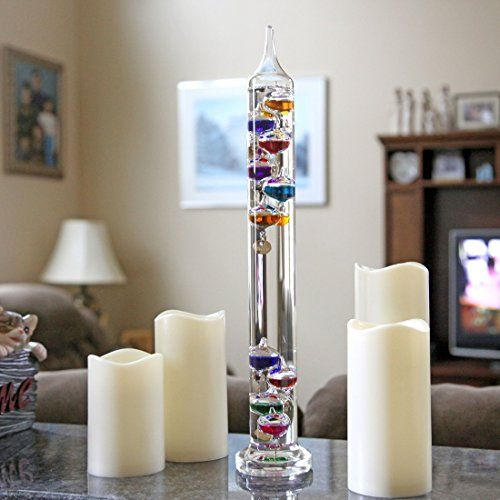 Lily's Home® 17 inch Galileo Thermometer, with 10 Multi Colored Spheres in Fahrenheit and Gold Number Tags  Lily's Home® 17 inch Galileo Thermometer, with 10 Multi Colored Spheres in Fahrenheit and Gold Number Tags Galileo Thermometers are magnificent creations that make Galileo's 400 year old principle of relative density a functional reality. An accurate indoor thermometer encased in brilliant glass, the Galileo is the point at which art meets science. Galileos add sparkle and focu..