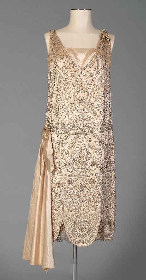 Silk satin wedding dress shown without the train~Image via Kent State University Museum. https://kentstateuniversitymuseum.wordpress.com/2015/05/22/wedding-inspiration-from-the-1920s/