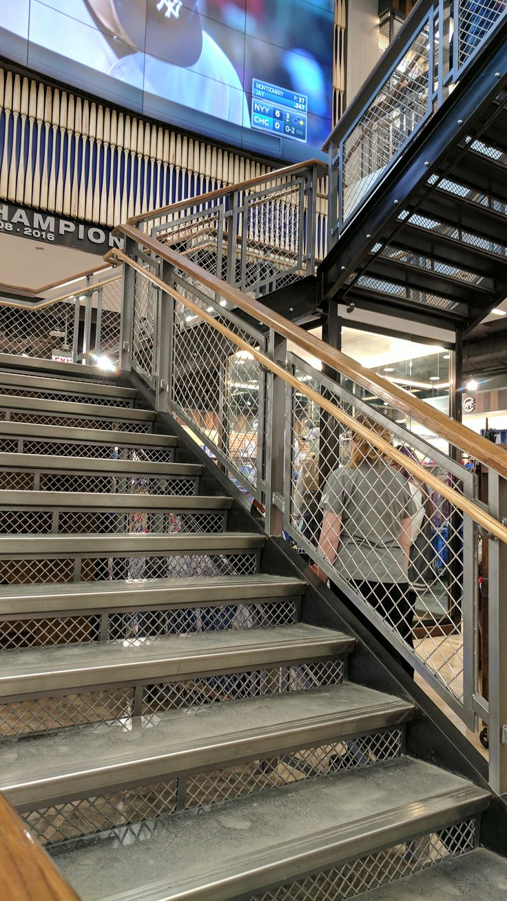 """McNICHOLS® Wire Mesh rises to the occasion! The product forms infill panels and stairway risers for the Cubs Store at Wrigley Field in Chicago. The product is Carbon Steel, Cold Rolled and features a 1"""" Opening (Square), .192"""" Thick Wire Diameter and 70% Open Area. Our Wire Mesh selection is available to browse online at mcnichols.com/products/wire-mesh."""