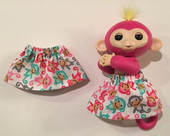 Handmade Fingerlings Monkey Skirt:  THE SKIRT: Elastic waist and was made to fit the popular Fingerling Monkey Toys  THE FABRIC: White cotton with colorful mini monkeys all over. The SIZE: 2 inches long  Perfect for any monkey lover. Makes a great little gift for the holidays or for a Birthday surprise.  ~Monkeys are very popular this holiday season and on the 2017 Hot Toy List~  This is a finished skirt that is ready to be shipped very quickly.
