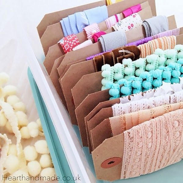 organized+ribbons+on+tags 24 Creative Craft Room Storage Ideas