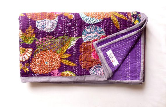 Beautiful Kantha bedspread in gorgeous purple floral pattern    This fabric is made with just two layers of cotton which has been quilted together