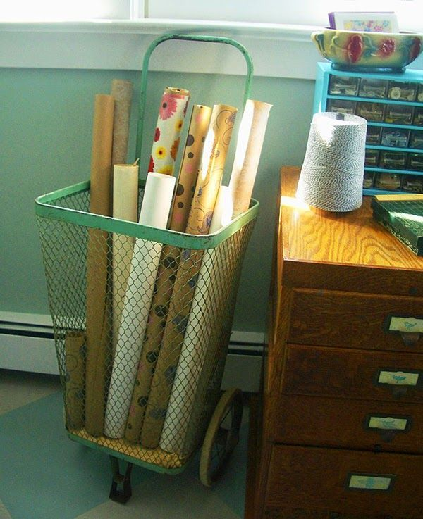 Like decor - bowl on storage caddy. Vintage shopping cart used as wallpaper storage