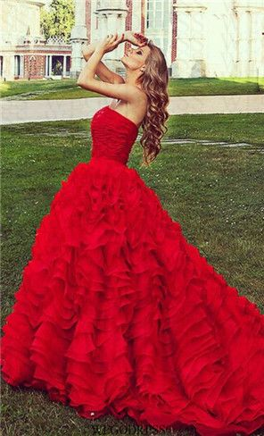 Gorgeous red dress, nice pic, the way her hair matches the ruffles of the dress, the green of the grass really brings it out, celebrate Click pic