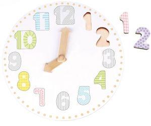 Jabadabado Leksaksklocka & PusselFin leksaksklocka i trä med siffror och rörlig visare...