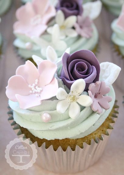 Cupcake clustered with a variety of sugar flowers.