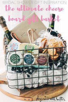 bridal shower gifting inspiration!  get the bride in your life ready for entertaining & being the hostess with the mostess with this cheese board gift basket - fill a cute basket with your favorite wine, cheeses from trader joe's & some cheese knives off her registry! | bridal shower idea, bridal shower gift, wedding gift, food gift, gift basket |