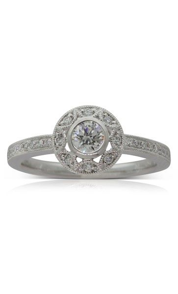 18ct white gold .30ct diamond halo ring
