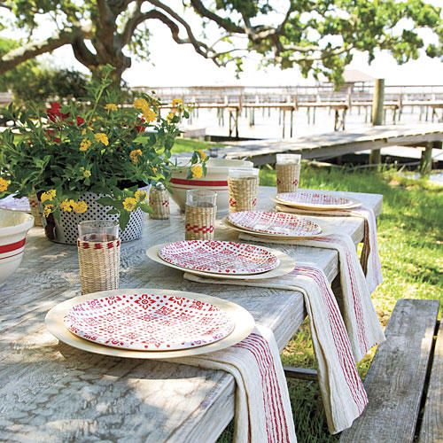 Set a Pretty Table - This Summer's Best Outdoor Menu - Southernliving. Set a simple and pretty table with natural bamboo plates topped with plastic patterned ones. Inexpensive dish towels as napkins complete the look.