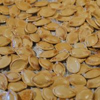 baking pumpkin seeds at the moment. Added a little cinnamon, ginger, and nutmeg. YUM! Hope they turn out.