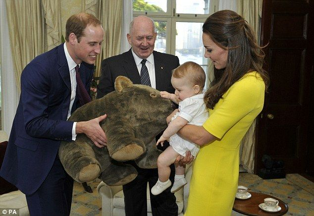 Prince George looks delighted as he receives a giant stuffed wombat gift from the Governor-General Sir Peter Cosgrove at Admiralty House, where he was reunited with his parents later in the day