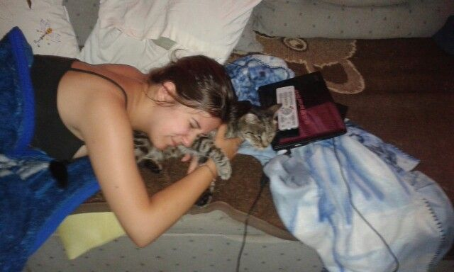 Sister sleeping with her cat
