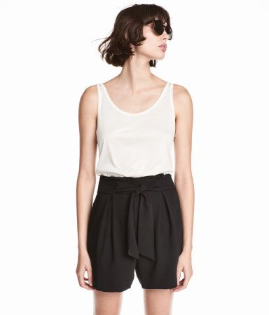 Black. Wide-cut, high-waisted shorts in woven fabric. Pleats at top, zip fly, tie belt, side pockets, and welt back pockets.