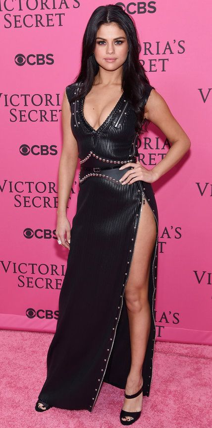 Selena Gomez in a tough black leather studded high-slit Louis Vuitton gown.