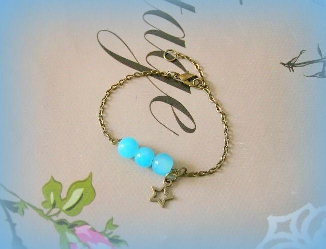 Bracelet bronze perle en verre bleues étoile fait mian unique créateur : Bracelet par papillon-sucre