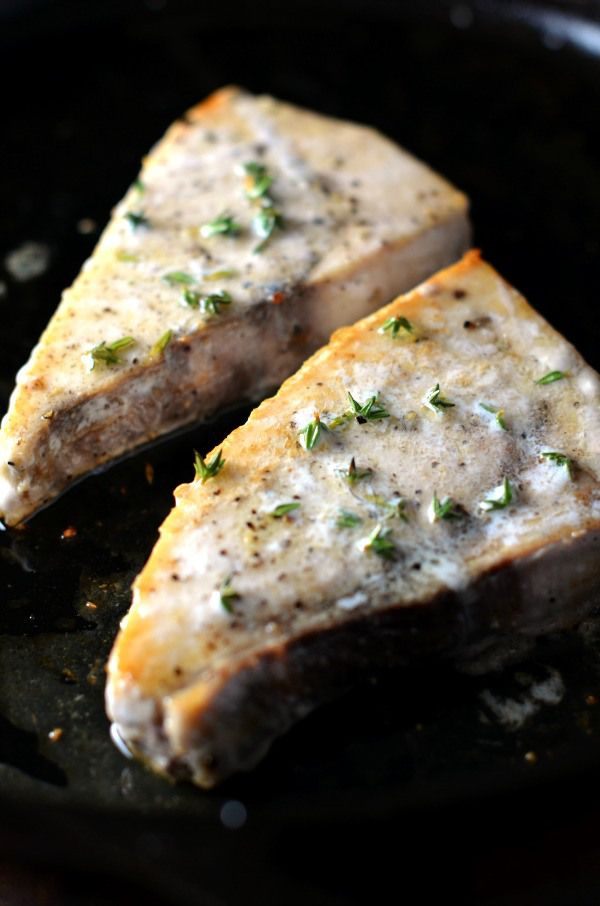 swordfish steaks in cast iron skillet with lemon and thyme