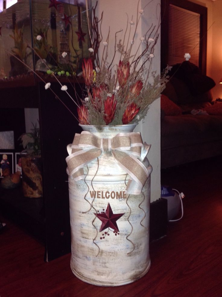 Old milk jug restored to distressed welcome home decor
