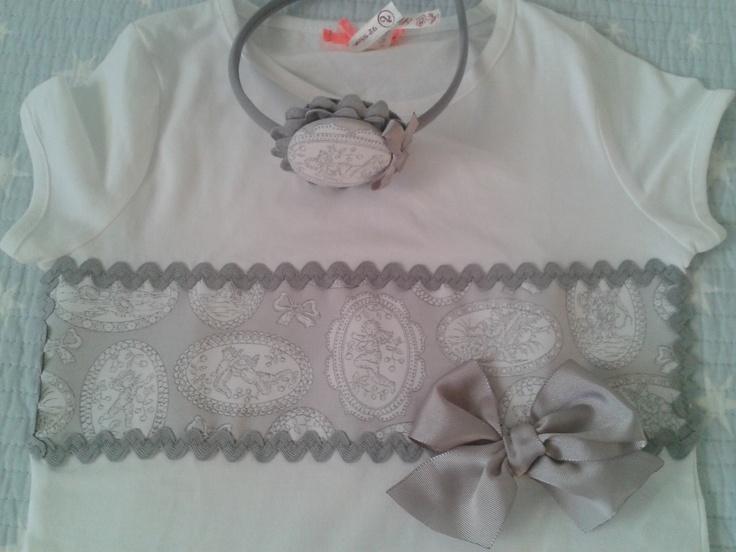 Cenefa medallones en gris y blanco.