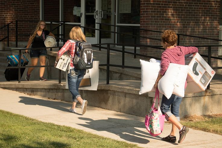 Brooks Hall residents move in Thursday, Aug. 18, 2016, with the help of family members and Chadron State College New Student Orientation Eagle Leaders. (Photo by Tena L. Cook/Chadron State College)