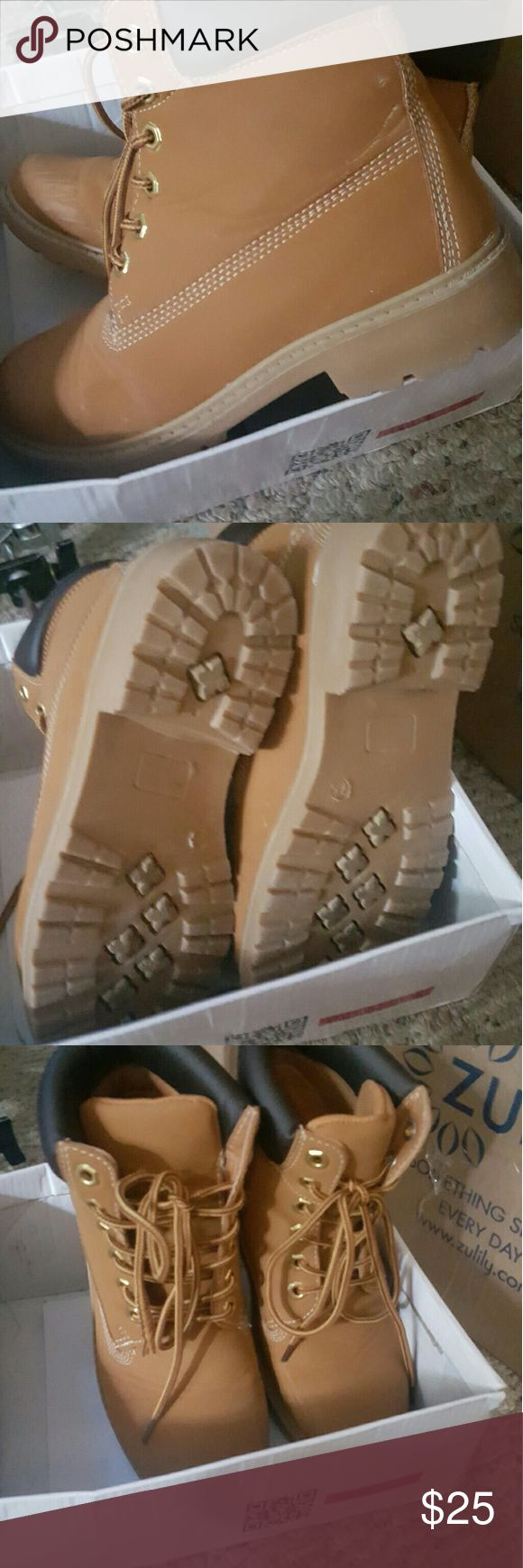 Timberland style boots These are in new condition. Worn once. They are NOT Timberlands but look just like them. Timberland style Shoes Combat & Moto Boots