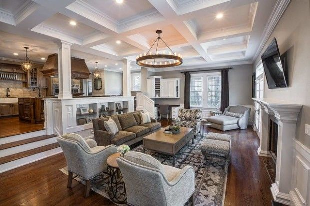 Transition from Kitchen to Family room with step down, columns & built in book case.
