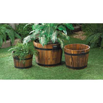 This trio of planters have look of aged oak barrels, complete with black metal banding and handles for ease of relocating around your yard as the mood or sun strikes. Each planter has a different size to allow you to make these the charming homes for a variety of plants.
