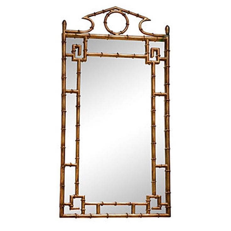 "We love this Chinoiserie bamboo gold mirror. It is perfect for over a chest or a console table. This is our new favorite mirror! Dimensions: 42"" H x 21""W Materials: Iron and Glass"