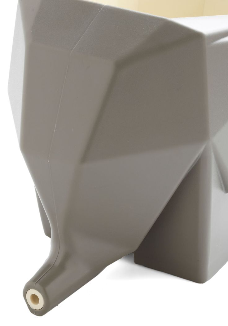 With this adorable elephant caddy, you can keep your kitchen or bathroom clean, chic, and cleverly organized! Shaped like a faceted grey elephant, this cutlery cup or sink-side storage unit drains from out of its trunk, helping to keep your countertop spotless and super-fun!