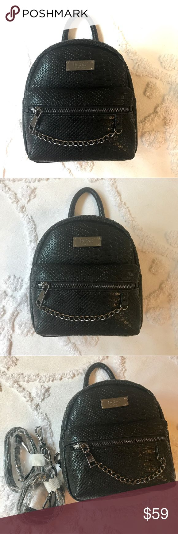 BCBG Paris Main Street Petite Backpack BCBG Paris Main Street Petite Backpack in Black Faux Snakeskin. This bag features faux snakeskin, silver-toned hardware, adjustable and detachable back straps, and a top carry handle. There is a front zip closure pocket. You can surely fit your essentials and more into this beauty! NWT. Measurements listed are approximate. BCBG Bags Backpacks