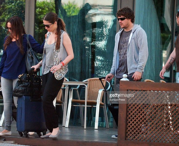 Singer Dani Martin (R) and his girlfriend Huga Rey (C) are seen on May 26, 2012 in Cadiz, Spain.