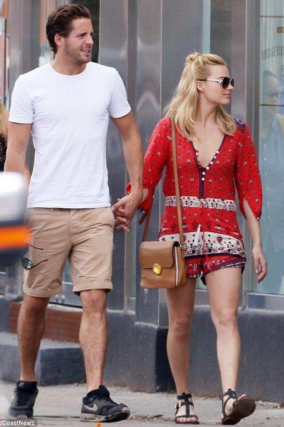 Margot Robbie wearing Spell & the Gypsy Collective Desert Wanderer Playsuit in Sunset and Matt Bernson Km Gladiator Sandals