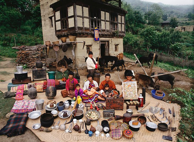 A neighboring family of Nalim and Namgay was photographed in the village of Shingkhey, Bhutan, for the Material World Project. They are show...