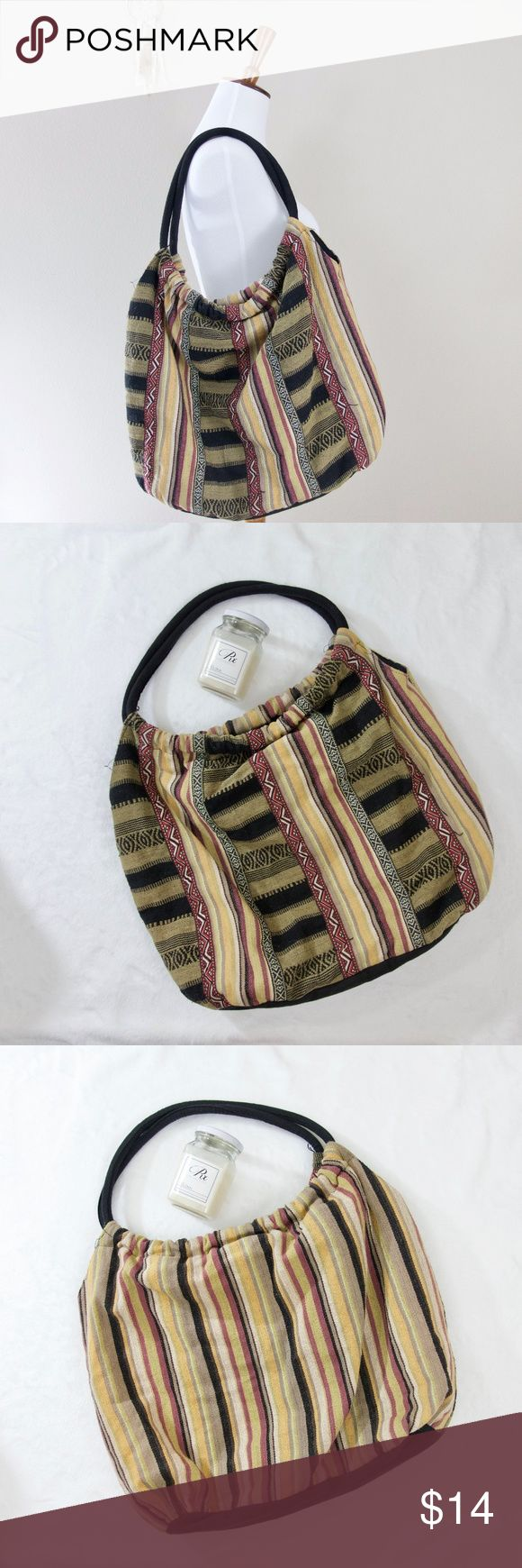 World Market Tribal Aztec Tote Shoulder Bag World Market Tribal Aztec Tote Shoulder Bag  * Preowned, used for class a few times * In great condition! Minor pilling on exterior, interior is clean * Has a button clasp on the top * 1 inner zippered pocket, 2 small inner pockets * Light weight material * Can be worn on either side! Bags Totes