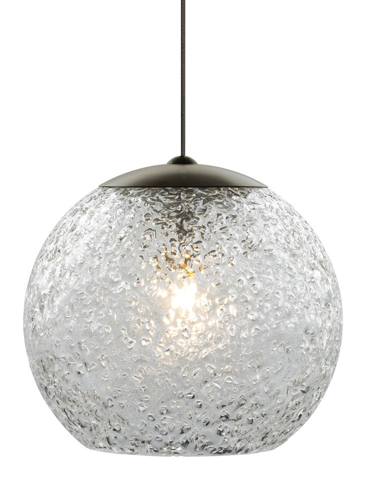 Available in clear shown or smoke the mini rock candy round pendant light from lbl lighting is a sphere of hand blown transparent glass rolled in a