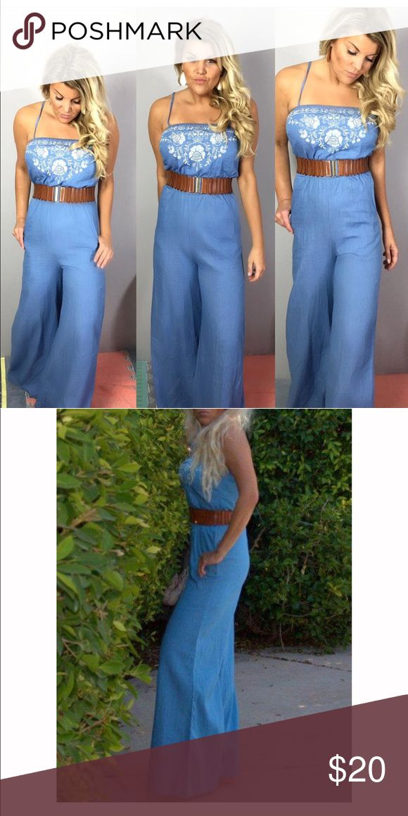 Blue jean jumpsuit Embroidered denim jumpsuit that features adjustable spaghetti straps, elastic waist and wide leg style. 100% cotton.  Does not include belt Flying Tomato Pants Jumpsuits & Rompers