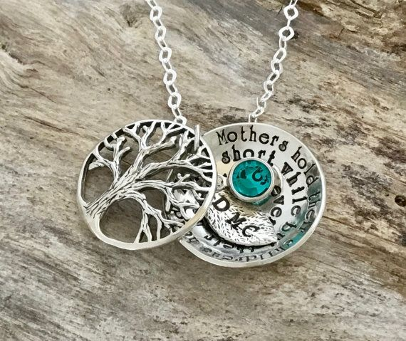A tree locket created just for Mom but can also be for grandma,friend or any other family member. Add your own phrase or alter the phrase provided. ♥ Listing includes: ♥ Swarovski crystal for Birth Month ♥ Sterling Silver detailed tree of life ♥1 Sterling Silver bottom disc example shows a personalized message, if your unsure on a personalized message an example phrase Mothers hold their childrens hands for a short while but their hearts forever. ♥ Tiny leaf stamped with initial ♥ All…