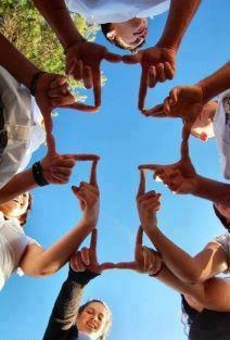 6 people hands to make a beautiful cross