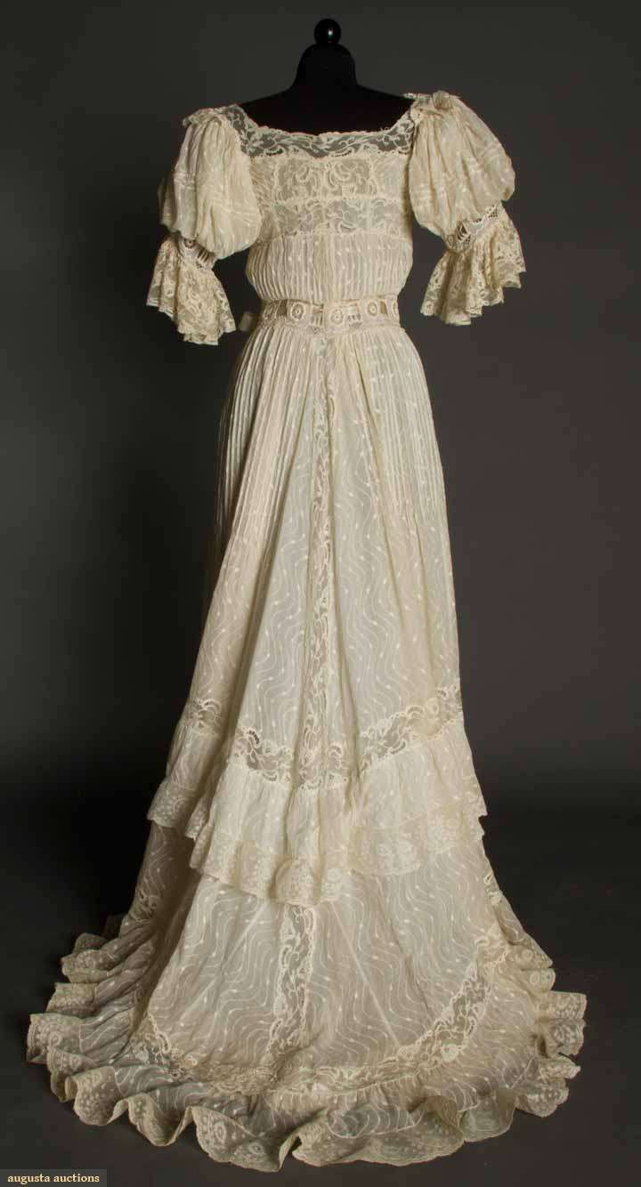 IVORY LAWN & LACE TEAGOWN, c. 1905 Pin-tucked cotton woven w/ serpentine-dot pattern, embroidered lace inserts at waist & short sleeves, Val lace trim, trained skirt, ivory China silk lining. Back