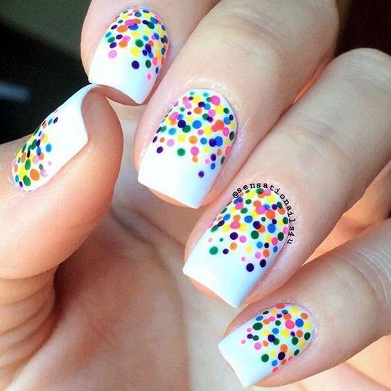 Adorable vibrant colors polka dots on white base nail art.