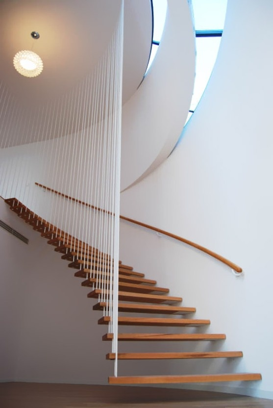 I adore circular features in a house..maybe this is a turret..wooden stairs combined with white walls is to me so stylish