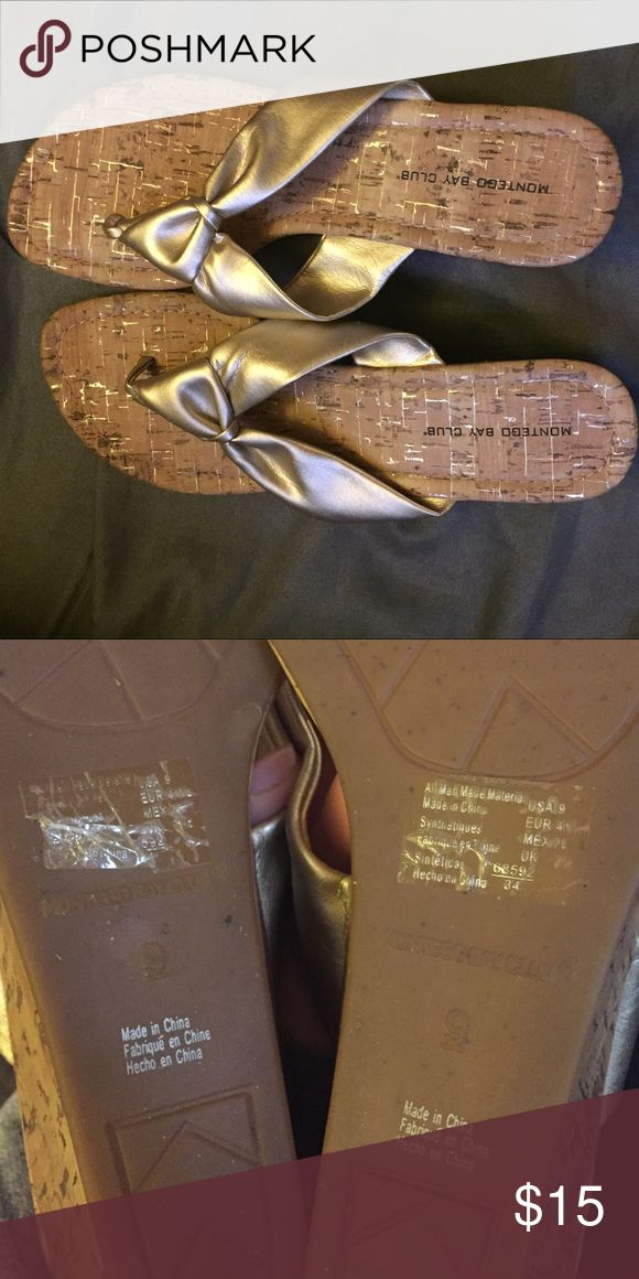 Size 9 Montevideo Bay heeled sandals Size 9 Montego Bay Club heeled sandals. Gold straps and faux cork material. Worn once outside, size stickers are still attached to bottom of shoes. Montego Bay Club Shoes Sandals