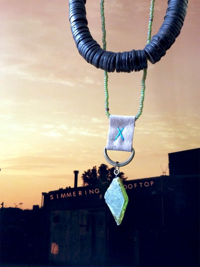 TUARI necklace & the photograph: 'Simmering Rooftop'