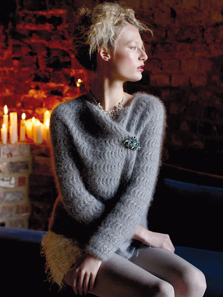 Chilly - Knit this ladies loose fitting cardigan from Rowan Knitting & Crochet Magazine 58, a design by Vibe Ulrik using the ever popular yarn Kidsilk Haze (mohair and silk.) With draping extending fronts that can be fastened with a pretty brooch, this knitting pattern is suitable for the more advanced knitter.