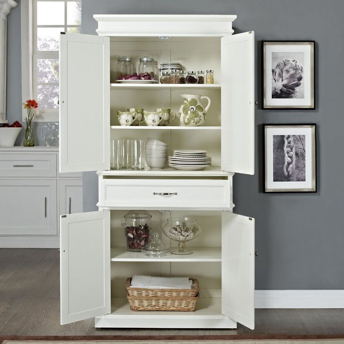 Perfect stationed in the kitchen or living room, this essential cabinet features spacious storage for dry ingredients, serveware, entertainment accessories, and more.