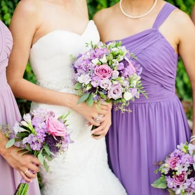 Love this shot of the bridal bouquet and bridesmaids bouquet. Beautiful natural garden look of roses, freesia, stock, lisianthus and more from Strelitzia Flower Company!
