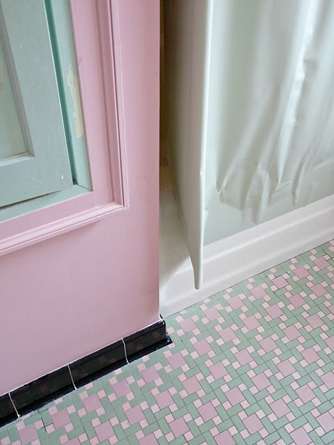 a wonderful vintage pink black and green bathroom with amazing tile on the floor