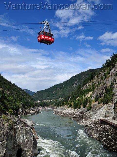"""Hell's Gate Airtram Going Over the Fraser River, British Columbia ~ """"Taking one minute to descend and ascend, the Hell's Gate Airtram is one of two means to access the village alongside the Fraser River. Fitting up to twenty-five guests, the trams cross over the raging Fraser River below and offer spectacular views.""""    Read more: Hell's Gate Airtram Going Over the Fraser River"""