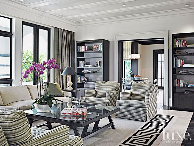 A Coral Gables, FL home's cozy family room. | See MORE at www.luxesource.com. | #luxemag #interiordesign #design #interiors #homedecor